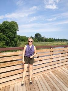 Maureen taking a break on bridge